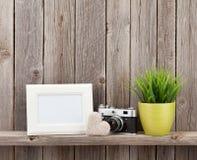 Blank photo frame, heart, camera and plant Royalty Free Stock Photos