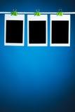 Blank photos on blue background Royalty Free Stock Photos