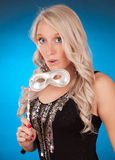 Blond girl holding silver mask Stock Photos