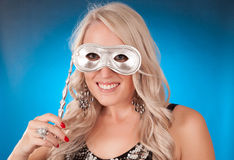 Blond girl holding silver mask Royalty Free Stock Photography