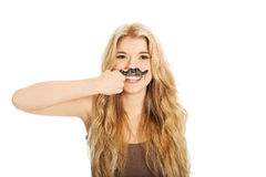 Blonde student with mustache looking at camera Stock Photo