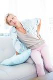 Blonde woman having backache Stock Photos