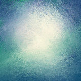 Blue and green background with white center and sponged vintage grunge background texture that looks like water or waves border Royalty Free Stock Photo