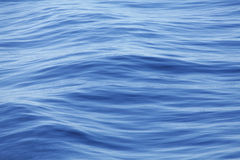 Clear blue water background Stock Photography