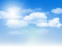 Blue sky with clouds and sun. Stock Image