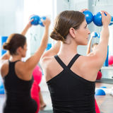 Blue toning ball in women pilates class rear view Royalty Free Stock Images