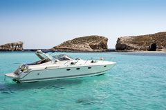 Boat on blue lagoon Royalty Free Stock Images