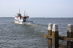 Boat leaving port Royalty Free Stock Image