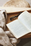Book and sweater Royalty Free Stock Photography