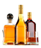 Bottles and glasses of alcoholic beverages on white Royalty Free Stock Images