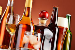 Bottles and glasses of assorted alcoholic beverages Stock Images