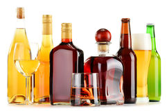 Bottles and glasses of assorted alcoholic beverages over white Stock Photos