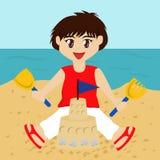 Boy Building Sandcastle Stock Images