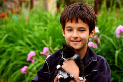 A boy with cat Stock Image