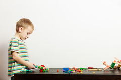 Boy child kid preschooler playing with building blocks toys interior Royalty Free Stock Image