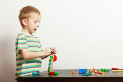 Boy child kid preschooler playing with building blocks toys interior Stock Photos