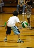 Boy dribbling basketball Stock Photography