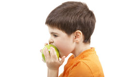 Boy eat the apple Royalty Free Stock Photos