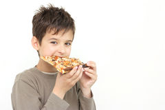 A boy eating pizza Stock Photo