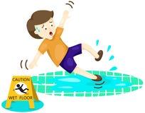 Boy falling on wet floor Royalty Free Stock Photo