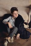 Boy in a fur coat Stock Photography