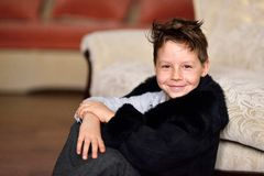 Boy in a fur coat Royalty Free Stock Images