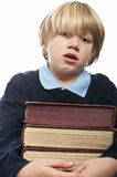 Boy holding a stack of books Stock Image