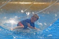 Boy lying in water sphere Royalty Free Stock Photo
