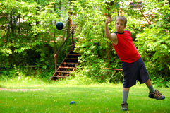 Boy Playing Bocce Ball Royalty Free Stock Photos