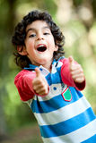 Boy playing outdoors Stock Image