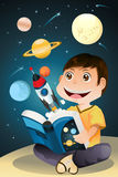 Boy reading astronomy book Royalty Free Stock Image
