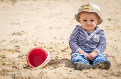 Boy in a sandpit Royalty Free Stock Images