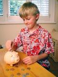 Boy Saving Money Piggybank Stock Photos