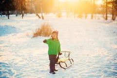 Boy Sledging In park Stock Photos