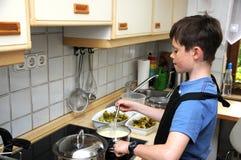 Boy stirring sauce Royalty Free Stock Photography