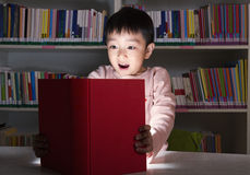 Boy Surprised By Glowing Book Royalty Free Stock Photos