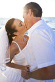 Bride & Groom Couple Kissing Sunset Beach Wedding Royalty Free Stock Photo