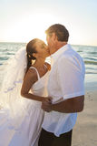 Bride & Groom Kissing Couple Sunset Beach Wedding Royalty Free Stock Photography