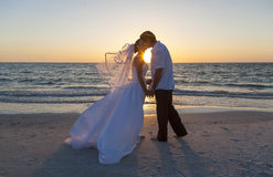 Bride and Groom Married Couple Sunset Beach Wedding Stock Images