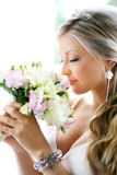 Bride smelling the bouquet Stock Image