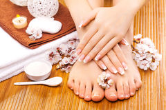 Brown manicure and pedicure on the bamboo Royalty Free Stock Images