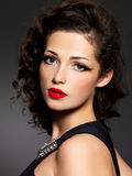 Brunette woman with fashion makeup and red lips Stock Photo
