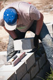Builder laying stones Royalty Free Stock Images