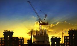 Building and crane construction site against beaut Stock Image