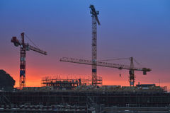 Building under construction at sunset. Night scenes Stock Image