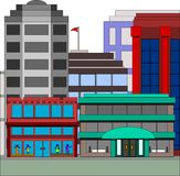 Buildings in the city with clothing store Stock Image