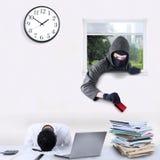 Burglar stealing credit card in office Stock Photos