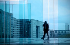 Business concept with businessman in office building Stock Photos