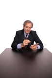 Business man on a desk Royalty Free Stock Images