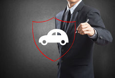Business man drawing shield protecting auto car Royalty Free Stock Photography